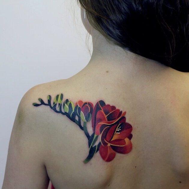 bold freesia flower tattoo design on back shoulder blade