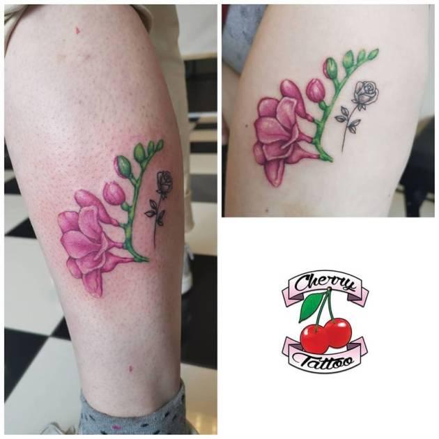 cherry color freesia flowers tattoo design