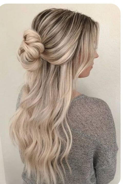 cute half updo with spiral waves hairstyle for winter