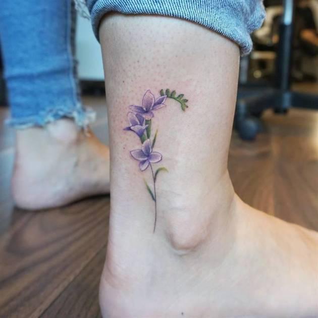 purple flower tattoo on ankle