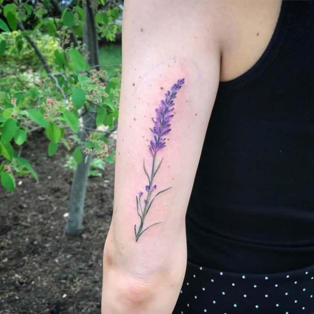 purple lavender sprig tattoo on back upper sleeve
