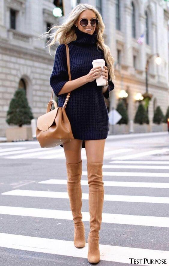 dark blue turtle neck sweater with nude knee length boots outfit