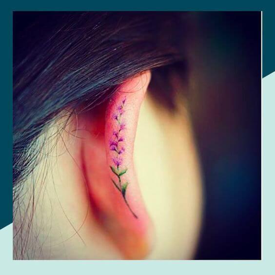 tiny lavender sprig tattoo on ear