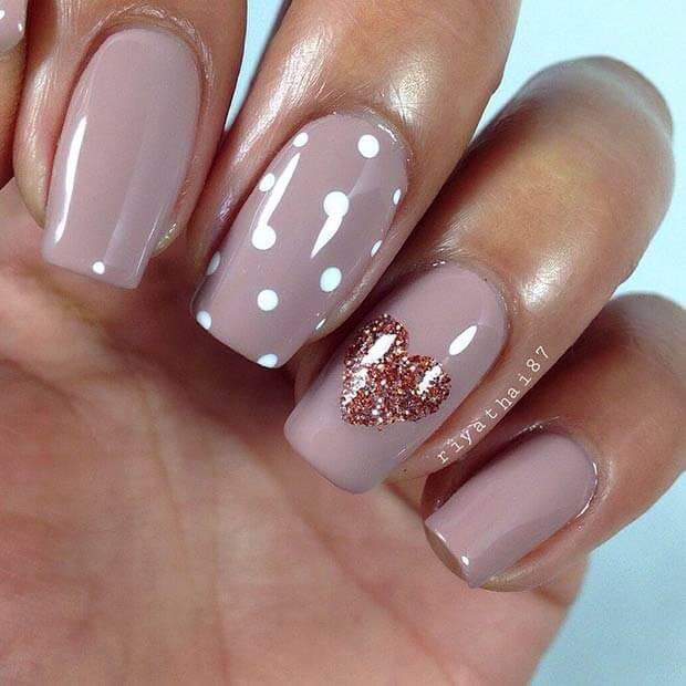 dark nude polka dots and glittery heart nails