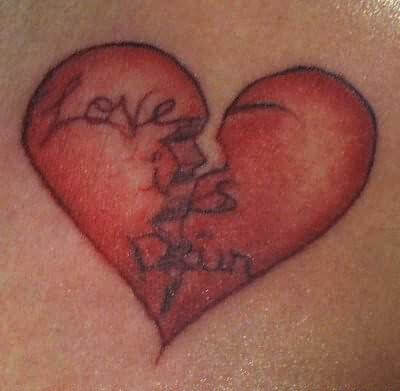broken heart with love is pain text tattoo design