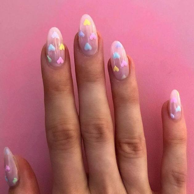 nude multi-colored pastel hearts nails design