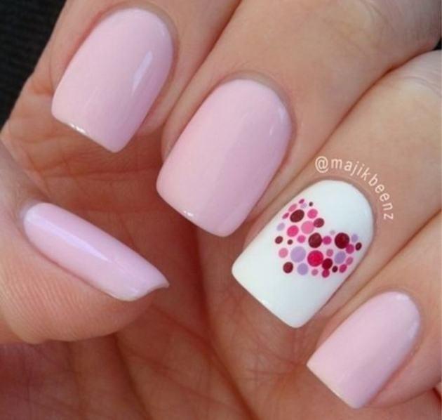 polka dots heart on pastel pink nails