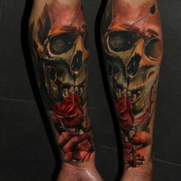 skull and bleeding rose with hand tattoo design on arm