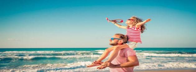 father and daughter enjoying summer at beach facebook cover photo