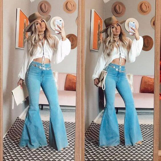 bell-bottom jeans matched with white puff sleeve top shirt and hat cowgirl outfit idea