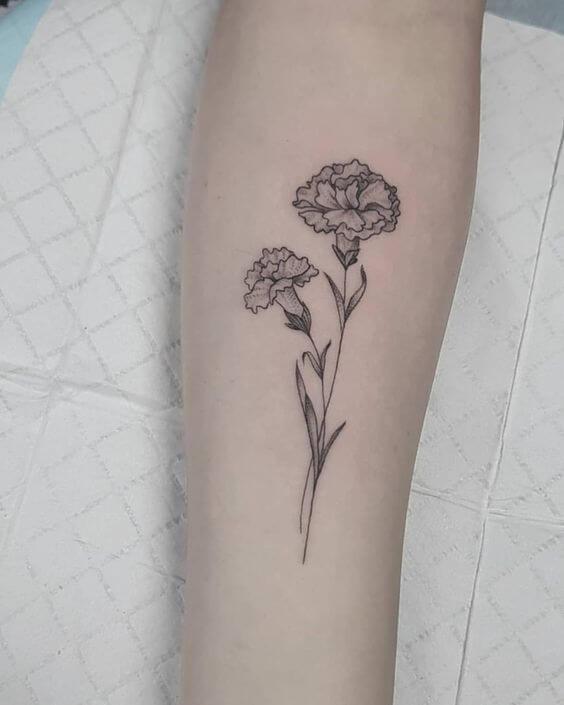 basic carnation January birth flower  tattoo design on forearm