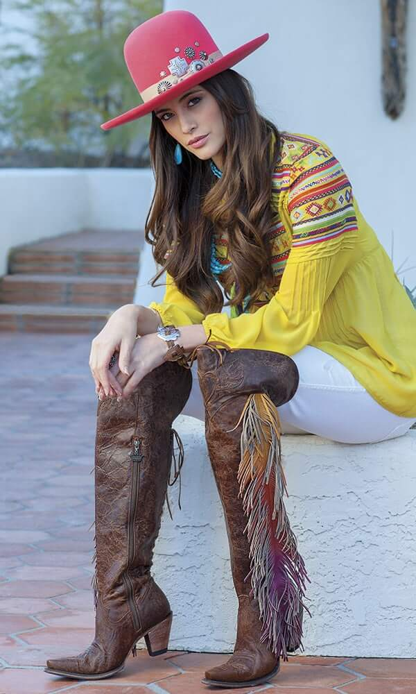 yellow top with knee high fringed rainbow boots- jeans and pink hat cow girl outfit  idea