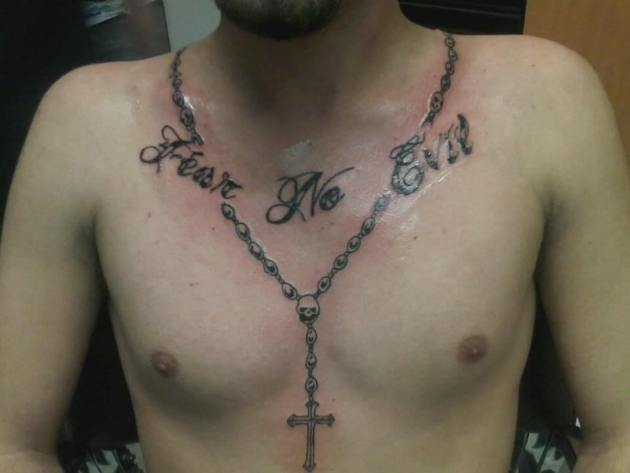 rosary beads with cross and fear no evil quote tattoo design on men chest