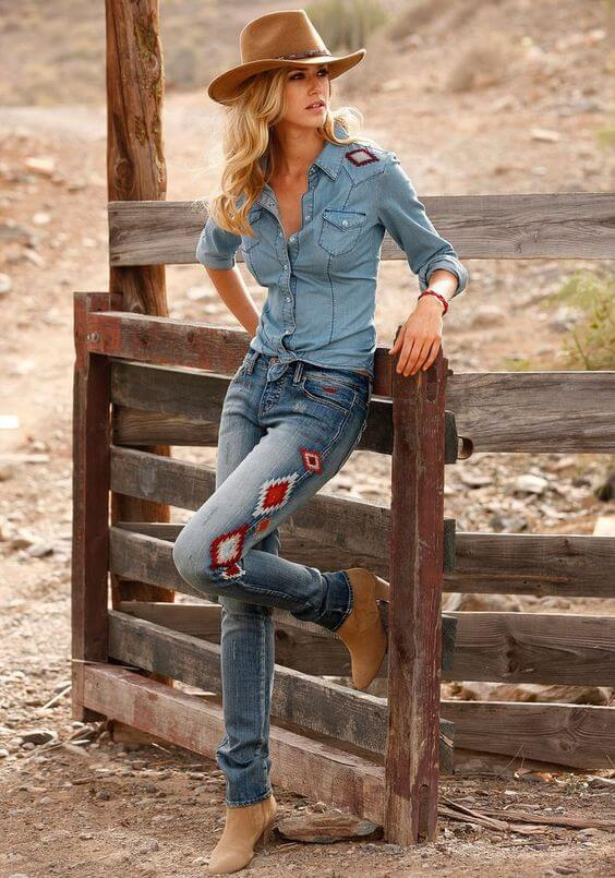 ankle boots with hat and patched jeans all denim cowgirl outfit idea