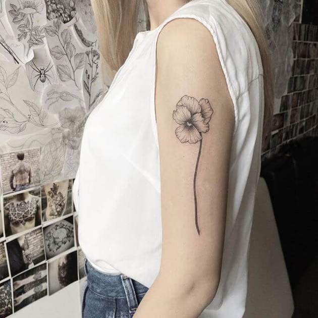 black and white viola flower bud tattoo design on upper arm