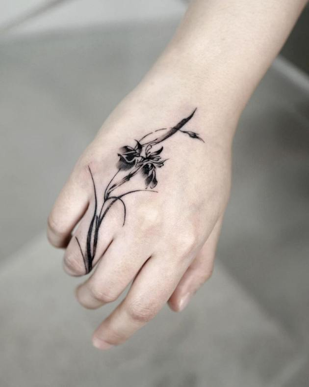 iris floral tattoo on hand