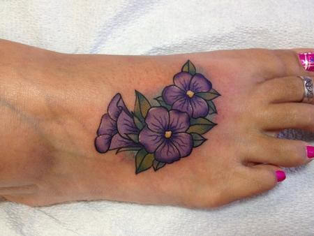 purple violet flowers with leaves tattoo design on foot