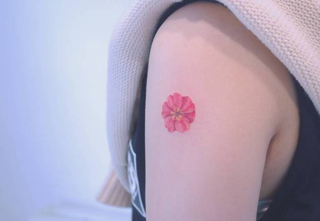 tiny primrose tattoo design on shoulder for females