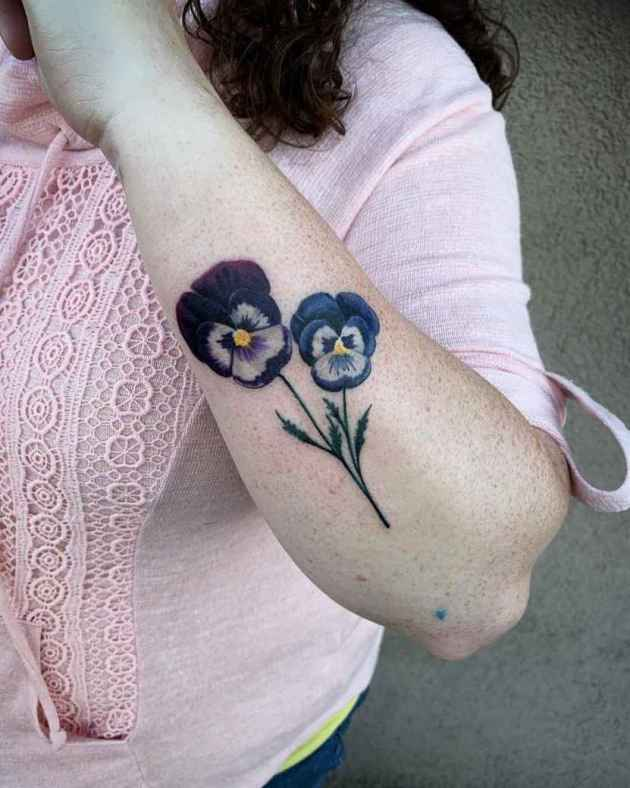 purple and blue violets bud tattoo design on side arm