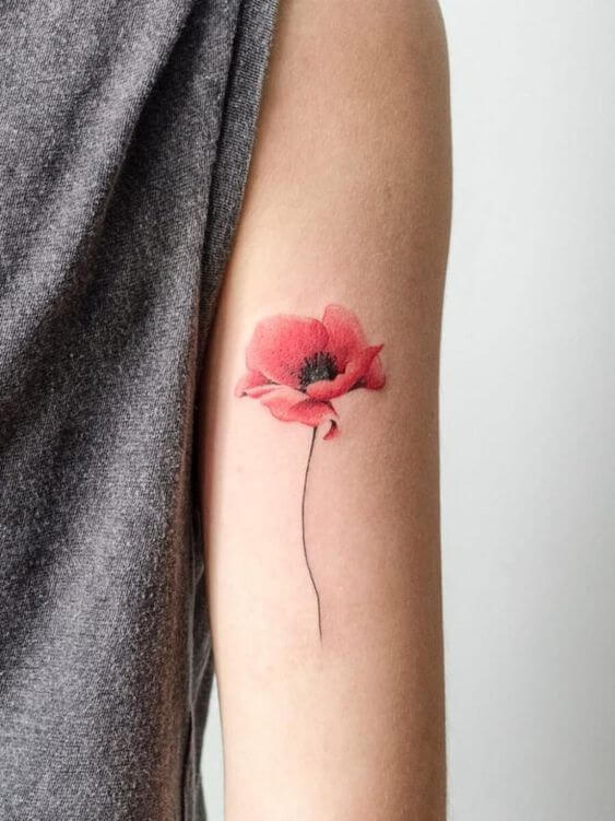 delicate august birth flower poppy tattoo design