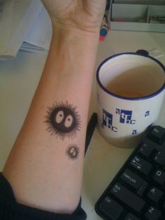 big and small soot sprite tattoos on wrist