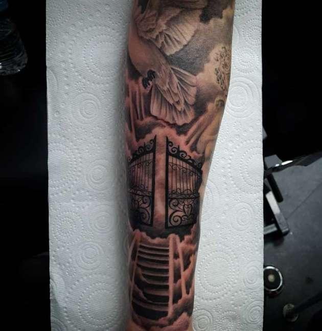 religious gates of heaven tattoo design on arm