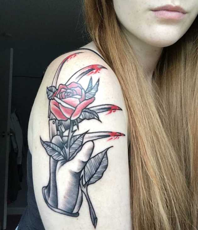 traditional rose with bloody Freddy Krueger claw tattoo idea for females