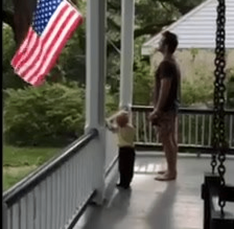 Chris recites the Pledge of Allegiance with his son Jack