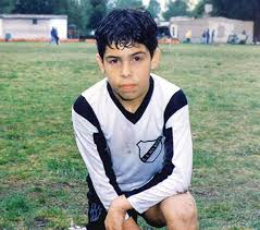 Carlos Tevez childhood photo one at twitter.com