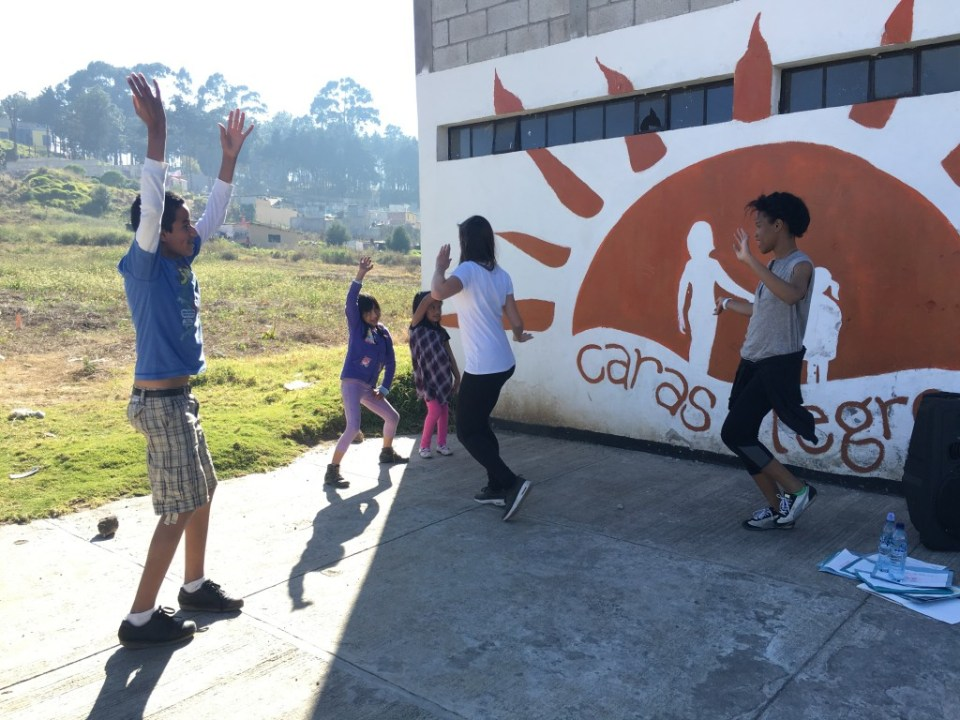 Photo by Nicole Tse. Christina and some of the kids dance during free time.