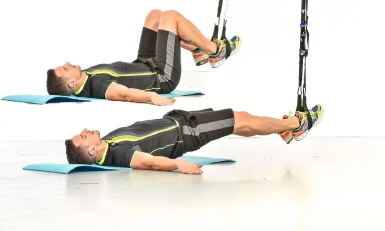 Flexiones de piernas en TRX