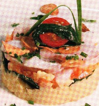 Bacalao con puré de garbanzos, tomate concassé y espinacas