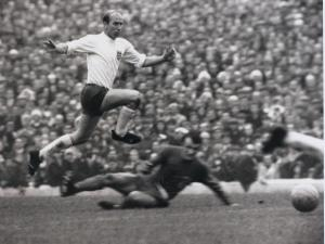 Sport. Football. British Championship (European Championship Qualifier). Cardiff. 21st October 1967. Wales 0 v England 3. England's Bobby Charlton leaps high to avoid a challenge as the ball runs free.