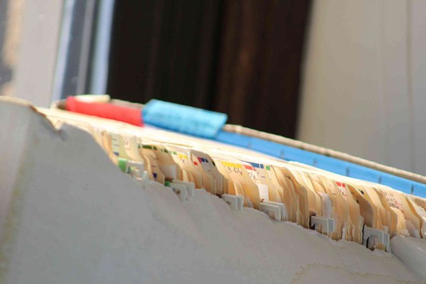 Tabs of old insurance files that can be used as evidence of historical insurance coverage