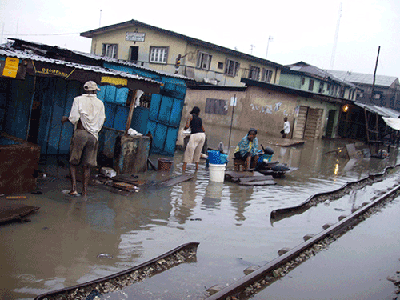No train in sight rev up a wet and gloomy rail line community at Agege, Lagos  Lagos during rainstorm in pictures Wheres the train