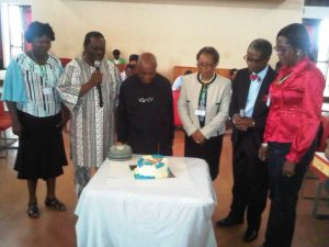 Prof Okali celebrating with colleagues