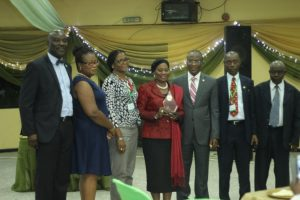 Lagos State Commissioner for Physical Planning & Urban Development, Toyin Ayinde (third from right); with Prof Leke Oduwaye (second from right); a representative of the Deputy Governor of Lagos State, Mrs. Orelope Adefulire (middle); Dr Taibat Lawanson (third from left); Dr Immaculata Nwokoro (second from left); Moses Ogunleye (left); and Prof Toba Olarenwaju (right)