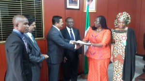 Minister of Lands, Housing & Urban Development, Akon Eyakenyi (second right), shaking hands with Anand Ramani (third left) of the Dubai-based Signature Value Homes. Minister of State, Federal Capital Territory (FCT) Development, Jumoke Akinjide (right); Permanent Secretary in the Lands, Housing & Urban Development Ministry, George Ossi, and other guests look on.