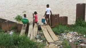 Solid waste dumped beside the Amassoma River. Photo credit: Jack Jackson