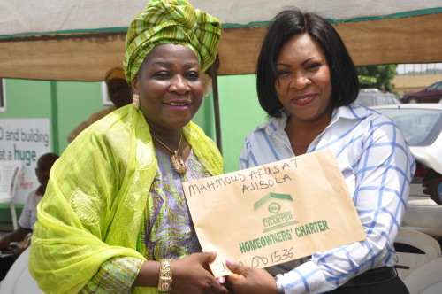 Mrs. Mahmoud Afusat (left), one of the beneficiaries of Certificate of Occupancy and Building Plan Approval of Ogun Homeowners' Charter Scheme, with Mrs. Abimbola Akeredolu, Ogun State Attorney General and Commissioner for Justice, during the presentation of Certificate of Occupancy and Building Plan Approval to the beneficiaries at Arcade Ground, Governor's Office, Oke-Mosan, Abeokuta, recently