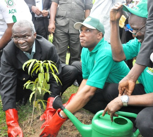Governor Babatunde Fashola (left) with Environment Commissioner, Tunji Bello, planting a tree to flag-off the 2012 Tree Planting Campaign. Photo credit: strategicindexblogspot.com  'Showcase accomplishment of tree planting initiative beyond Lagos' Treeplanting e1430034547311