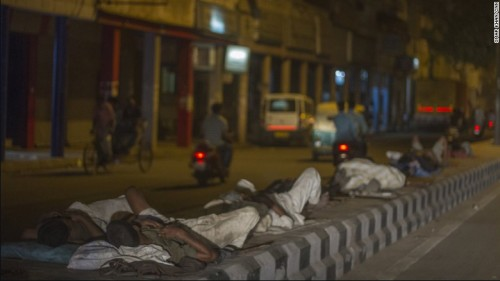 Men sleeping on concrete road dividers during a heat wave in Delhi, India. Photo credit: cnn.com