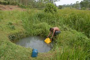 Chrispus Twikirize fetches water from their well in Ibaare, Igara Bushenyi district of Uganda  Worry over quality of surface water in Uganda chrispus twikirize fetches water from their well in ibaare igara bushenyi district of uganda 300x199