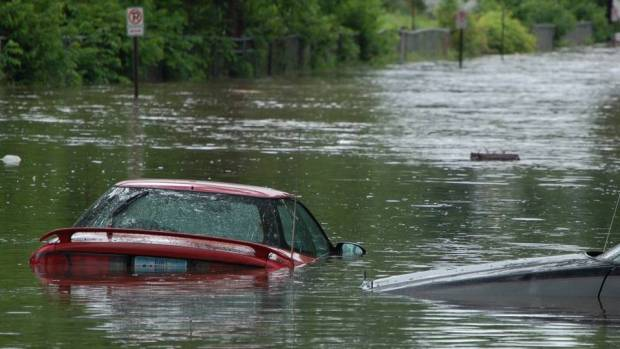 Cars stranded in the flood  13 dead in Missouri floods as Mississippi is closed to vessels Flood