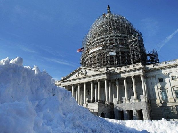 A massive Winter storm featuring bitterly cold temperatures and blizzard conditions has sparked a full shut down of government offices in Washington D.C  Washington records 'biggest winter storm in recorded history' snow capitol dome DC Getty 640x480