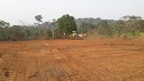 Bulldozers at work clearing the Super Highway's route passing through parts of Boki