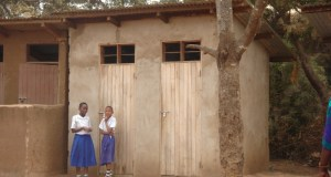 A school toilet for girls  IWD 2016: Hygienic toilets will keep girls in school, says WaterAid School toilet for girls in Tanzania 6880181036 e1457385180758