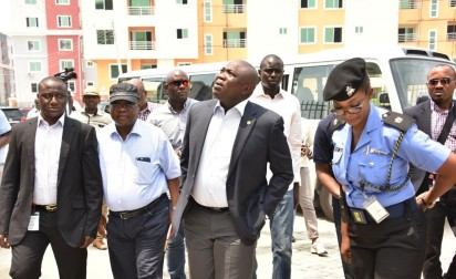 L-R: Lagos State Governor, Mr. Akinwunmi Ambode (2nd left); Divisional Police Officer, Ilasan Police Station, Mrs. Onyinye Onwuanaegbu; Commissioner for Physical Planning & Urban Development, Engr. Wasiu Anifowose and Commissioner for Works & Infrastructure, Engr. Ganiyu Johnson during the Governor's inspection of the site of the collapsed building in Lekki Gardens at Ikusenla Road, Ikate Elegushi, Lagos, on Tuesday. Photo credit: vanguardngr.com