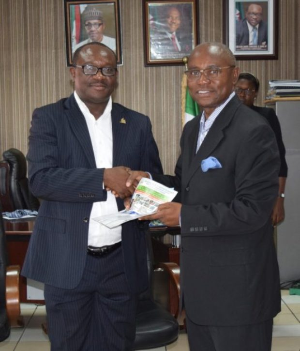Commissioner for Urban Development and Physical Planning, Chinyere Igwe, presenting the operational guidelines of the ministry to Dr. Emi Membere-Otaji, the PHCCIMA president