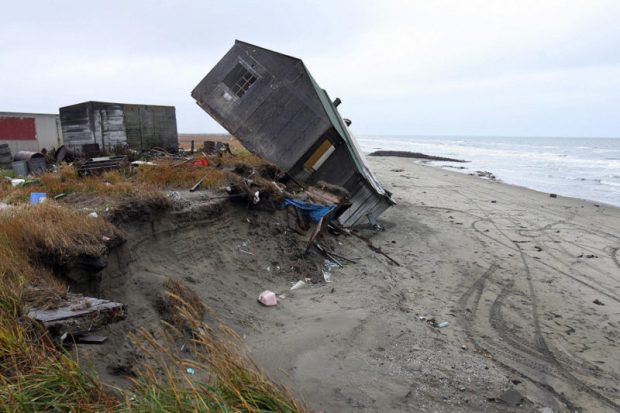 The remote village of Shishmaref, Alaska, has been experiencing the effects of climate change first-hand. In the last decades, the island's shores have been eroding into the sea, falling off in giant chunks whenever a big storm hits. Photo credit:: Gabriel Bouys/AFP/Getty Images  Climate change forces Alaskan village to relocate Alaska e1472011047295